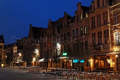 The Old Market (Oude Markt) in Louvain (Leuven), Belgium, captured at dusk.