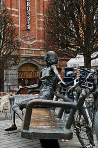 De Kotmadam, a bronze statue on the Old Market Square (Oude Markt) in Louvain (Leuven), Belgium. This statue represents the lady of the house who took care of the students who lived together in a building.