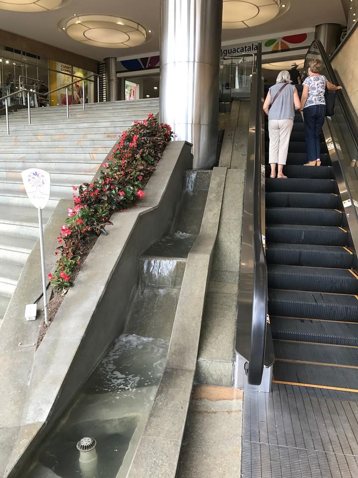 Entry to Santa Fe Mall has no doors, escalators up and waterfalls down