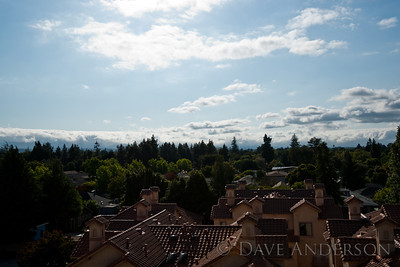 Looking over the top of Mountain view west of downtown - showing the mountains from which the city gets its name, with moist air from the ocean tumbling over the peaks.