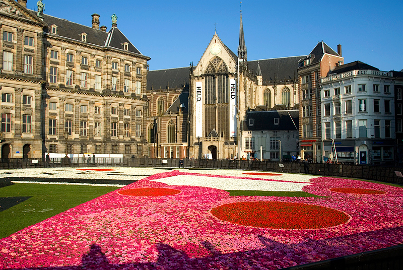 Amsterdam: Nieuwe Kerk (New Church) on Dam Square with the Held Exhibit banners, and the Flower Petal Mural on the Square
