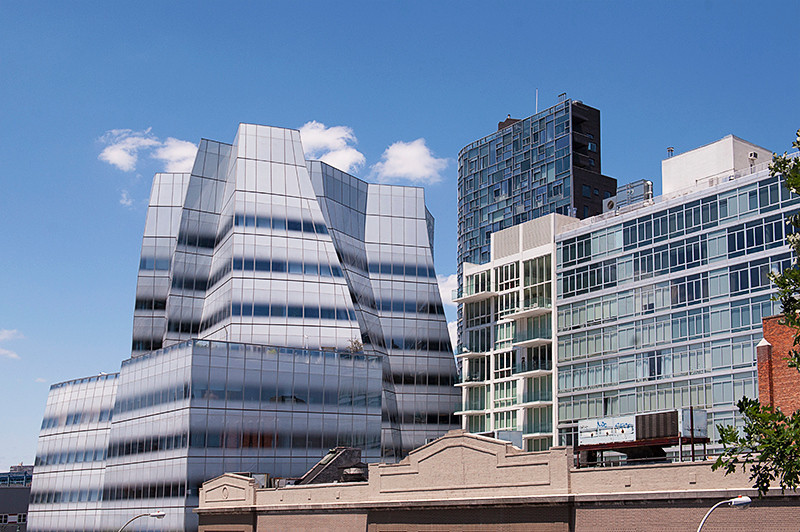 The High Line view down 18th toward the Hudson River of the IAC Headquarters designed by Frank Gehry