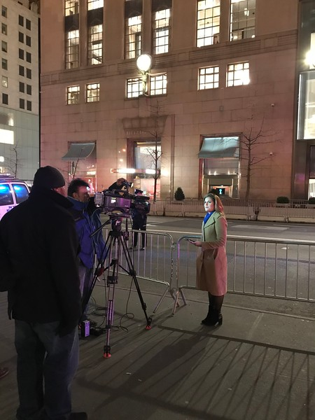 Reporter filing her report outside Trump Tower.