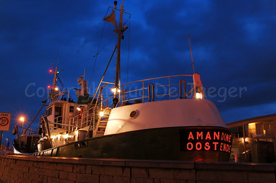 The O.129 Amandine is the last trawler that sailed from Ostend to Iceland. Built in 1960 at the shipyard Panesi, she sailed until 1995. Coming from Iceland, she arrived in Ostend on 3th April 1995. It has taken more then five year and a lot of money before she was restored and used as a museum at the Visserskaai in Ostend (Oostende), Belgium. Photo captured at dusk.