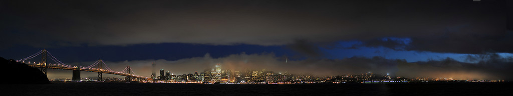 Fog over SF after dusk.