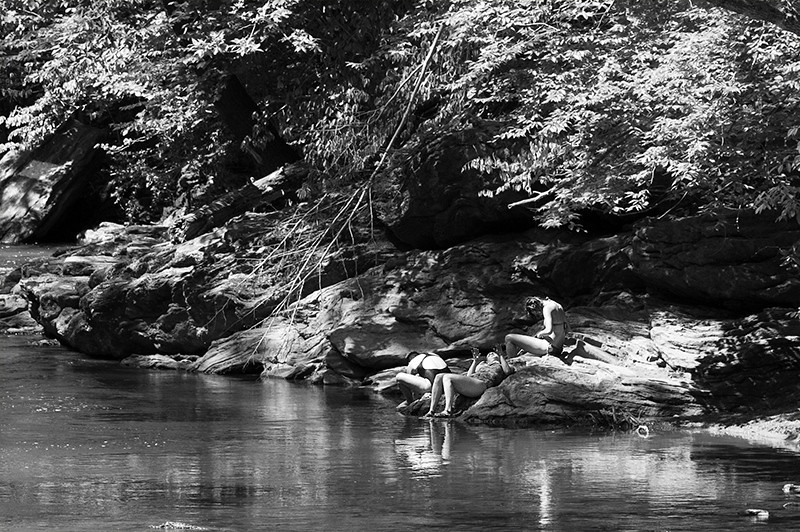 Bathers enjoying the Memorial Day holiday at Wissahickon Creek in Wissahickon Park of Fairmount Park in Philadelphia