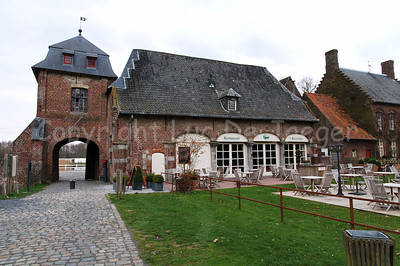 The restaurant in front of the Rumbeke Castle and aside of the entrance gate. The castle in Renaissance-style was built in the 16th Century. It can be found  within the Sterrebos Park near Roeselare, Belgium.