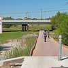 This view looks north toward Nacogdoches Road. Here the trail leaves forest and enters a meadow or seasonal marsh area. <br /> You cross the area using an innovative boardwalk. You can see it curving along the stream in the distance.