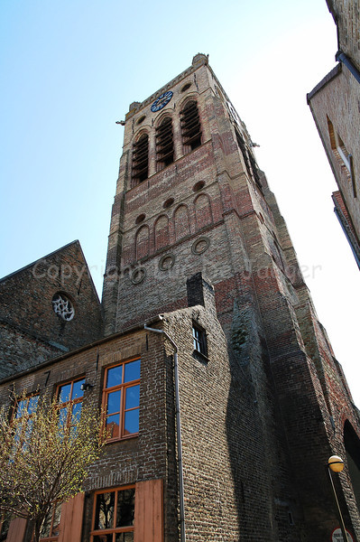 View on the Church of Saint Nicolas (Sint Niklaaskerk) in Veurne, Belgium. The tower measures 48m.
