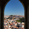 City viewed through castle's window in Lisbon