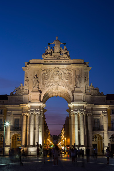 Arco da Rua Augusta and people at Praca do Comercio in Lisbon at dusk