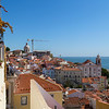 People and old buildings at Alfama in Lisbon