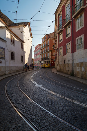 Tram and few people in downtown Lisbon