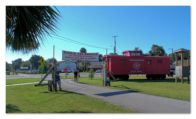 Trailhead crossing and caboose. Inverness