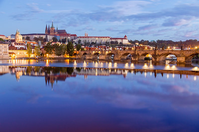 Charles Bridge with Castle during Sunrise