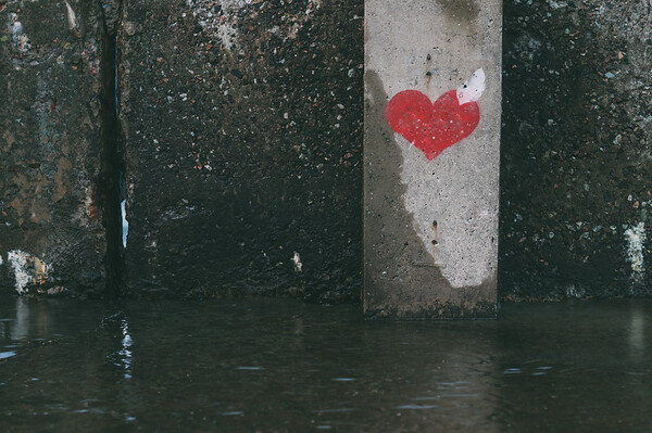 Heart symbol painted on a grunge wall