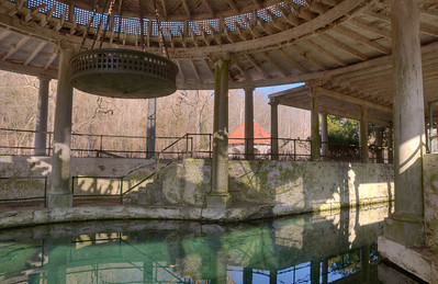 Peristyle spring house with pump house in background.