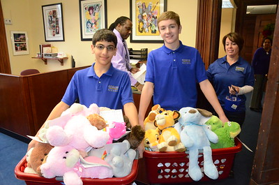 Rochester Christian School Students Donate Books and Bears 12/12/2014