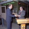 5/14/1992- Mayor Ryan receives check from president of Lionel Train Co. Nicholas de Arazia, Edgerton Recreation Center Train Room. Photo Credit: Communications Bureau, City of Rochester, NY