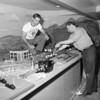 10/17/1950 Police Athletic League workers, including Patrolman Clarence DePrez (on left) install the model train set and layout at Edgerton Park Rochester Municipal Archives modern collection M571