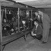 c. 1957 -Three men look at a large-scale model of a wood-burning locomotive in a display case at Edgerton ParkRochester Municipal Archives modern collection M632