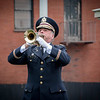 Sam Poulten plays the trumpet at the Memorial Day observance in front of the Ladd Whitney Memorial at City Hall. SUN/Caley McGuane