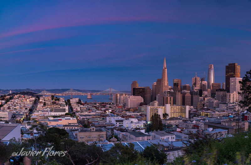 Panoramic of San Francisco skyline with the Bay Bridge at Sunset