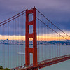Golden Gate Bridge with City skyline at sunset