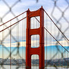 Golden Gate Bridge Through a Fence.