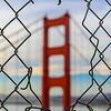 Golden Gate Bridge Through a Fence.