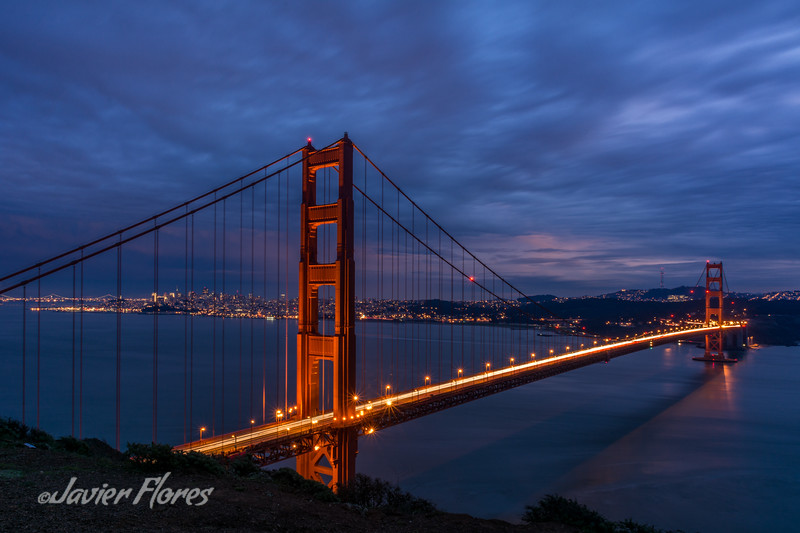 Golden Gate Bridge after sunset with San Francisco Skyline.