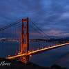 Golden Gate Bridge after sunset with San Francisco Skyline.