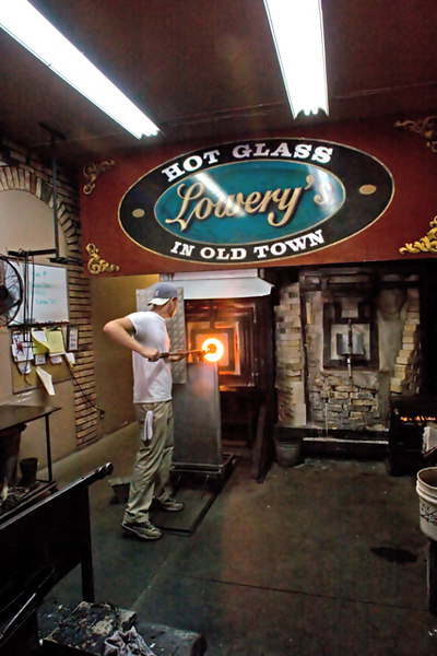"Heating the glass in the ""glory hole"""