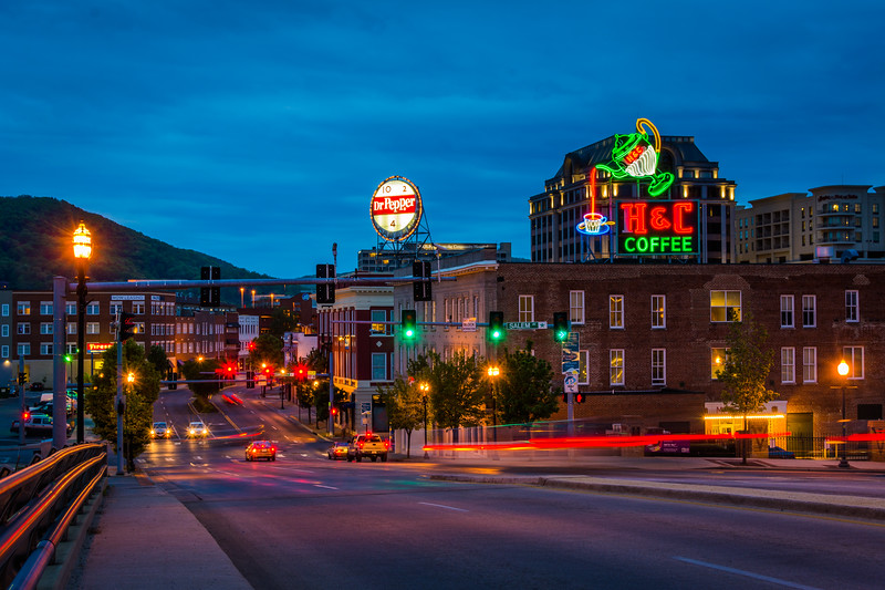 Neon signs and buildings along Williamson Road at night in downtown Roanoke, Virginia.