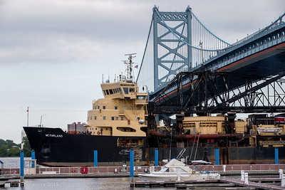 USACE Hopper Dredge McFarland passing under Ben Franklin Bridge.