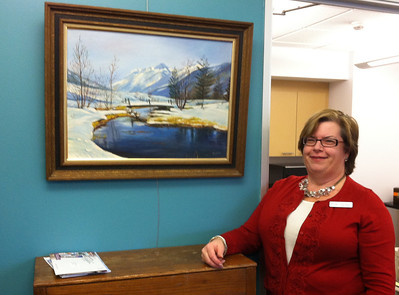 Kathy Bowler, Executive Director of the Holyoke Council on Aging, was happy to hang Norma's painting in a visible place by staff offices.