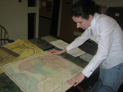 At the Holyoke History Room, Carla Wessells helped find old maps of Holyoke.