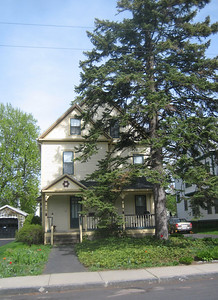 Our house at 56 Nonotuck, May 2007.  We thought it would be 100 years old in 2008, and considered having a party to celebrate. But research has shown that Mrs. Betsey M Cleveland, who owned the house in 1911 (see 1911 Atlas) lived here from 1899 on.  Water service was turned on Nov 15, 1894, according to records at Holyoke Water dept, so this house was 100 years old in November 1994 -- the very month we first saw it!  We bought it in 1995.