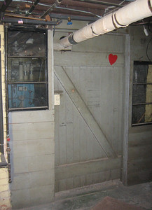 """This door in our basement has names and height markings from the past: Bobby Gantz 3'5"""" on 9-27-34, 3'7"""" on 6-28-35, 3'9"""" on 5-14-36, ... up to 5'3.5"""" on 6-7-44; Sandra measuring 2'10"""" on 6/20/40; and Bruce at age 3 1/2 measuring 3'3"""" on Nov 19, 1946."""