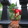 Contemporary Design and Construction, Inc. landscaper Richard Alvares work at Monument Park on Main Street in Fitchburg to help give it a make over on Tuesday. SENTINEL & ENTERPRISE/JOHN LOVE