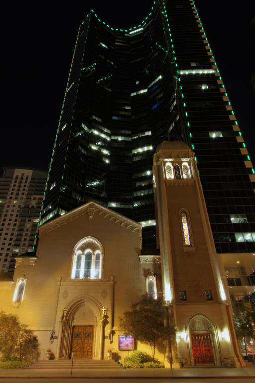 There are so many ways to look at this picture of this church and the building behind it ... but definitely we're talking about modern society overwhelming this more religious view of the world ... remember how spires on churches reach to the heavens, what can you say for our desire to build commercial real estate that dwarfs our religious symbols?