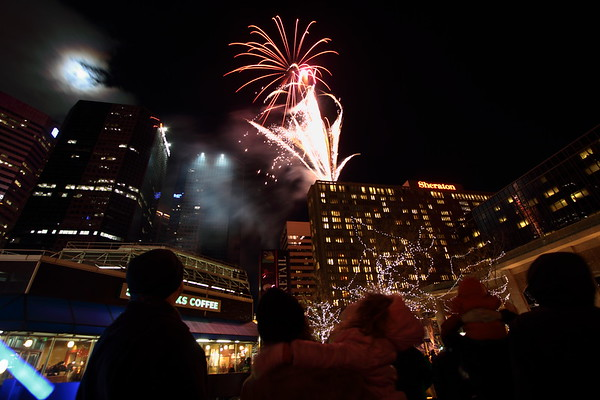 The New Year's 2010 Fireworks show with a Blue Moon rising over the downtown.