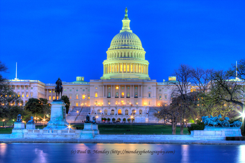 "And here is the capital building at night with the lights burning bright.  This is HDR but I cranked it down quite a bit.  The goal was to make this as ""real"" as I could.  Notice the curvature of the pool makes the picture look off balance, yet the capital is in balance ... I wanted the shot off center so this is the price one pays :)"