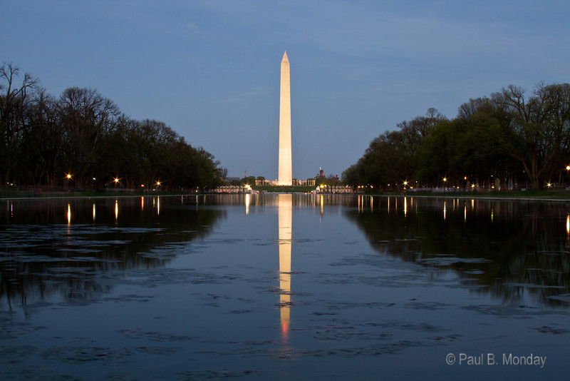 Having a wind-free sunset gives beautiful reflections in the reflecting pool ... but alas, the stuff all drifts toward one side.  Still, I did find it added a certain amount of character and moment.  Very majestic.
