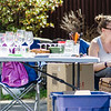Erin Ross sells glassware during the community wide yard sale in Fitchburg on Saturday. SENTINEL & ENTERPRISE / Ashley Green