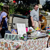James Greelish and daughter Damia sell their goods during the community wide yard sale in Fitchburg on Saturday. SENTINEL & ENTERPRISE / Ashley Green