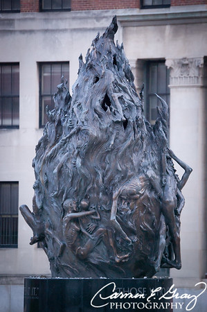 """Holocaust Memorial  - """"The Flame""""  At the bottom of the figure is a quote from George Santayana: """"Those who do not remember the past are destined to repeat it."""""""