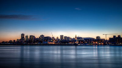 The City of Montreal in the evening, looking across the St Lawrence river from Parc Jean Drapeau