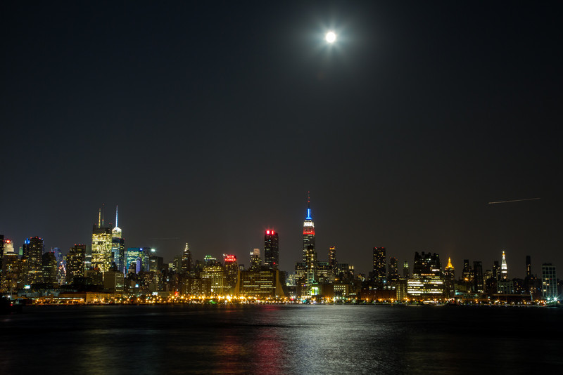 The Manhattan skyline under the full moon