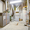 Mechanical room, featuring energy-efficient glycol heating system, furnace and hot water tank.